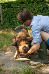 beautiful ginger black kune dune with owner